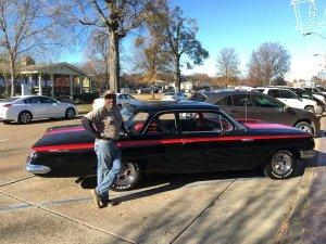 """Big J"" Milton Johnson of Johnson Plumbing beside his refurbished 1961 Chevy Bel Air"
