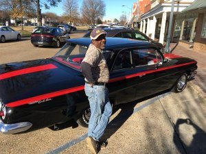 """Big J"" Milton Johnson of Johnson Plumbing beside his refurbished 1961 Chevy Bel Air"