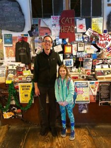 Mia meeting Roger Stolle, owner of Cat Head Delta Blues & Folk Art