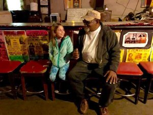Mia meeting Red Paden inside Red's Lounge in Clarksdale